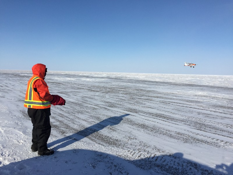 At Oliktok Point, Douglas Weibel from the University of Colorado, Boulder, pilots an unmanned aircraft gathering climate data, a capability that can be shared with researchers from six other nations in the pan-Arctic climate consortium.