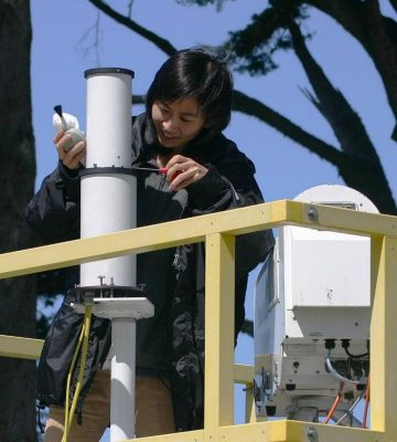 Chiu works on a 2-channel narrow field-of-view radiometer during 2005 fieldwork on the California coast.