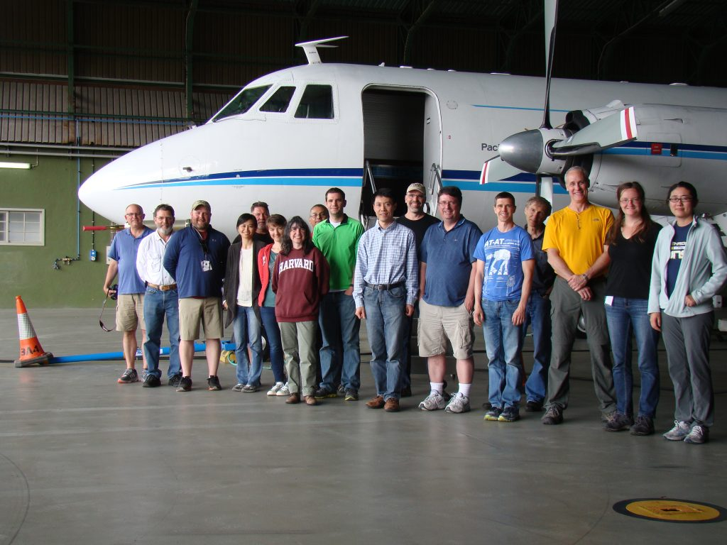 During ACE-ENA operations with the G-1 research aircraft in June 2017, Michael P. Jensen (center, in khaki shorts) posed with the research team. To his right is BNL's Jian Wang, the ACE-ENA principal investigator and also part of the SFA. Third from the right is the SFA's Arthur J. Sedlacek.