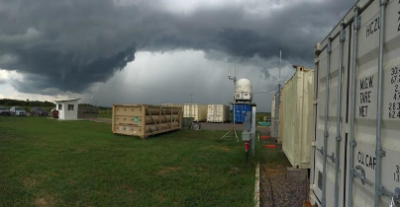 A dry-season rainstorm approaches the ARM Facility's Mobile Aerosol Observing System (MAOS) located southwest of Manaus, Brazil, at the T-3 site in Manacapuru. The aerosol content of the atmosphere is often greater when conditions are dry, due to additional particulates from forest burning and other activities.
