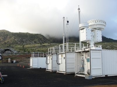 Smoke-filled clouds float toward the first ARM Mobile Facility (AMF1) on July 8, 2016, during the LASIC field campaign on Ascension Island.