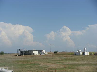 Storms gather in the distance at Southern Great Plains atmospheric observatory during the Midlatitude Continental Convective Clouds (MC3E) campaign, where Varble (still a graduate student) served as a weather forecaster. Photo courtesy of Varble.