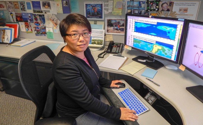 Lawrence Livermore National Laboratory cloud scientist Yunyan Zhang works a bank of computer monitors at her office at the Program for Climate Model Diagnosis and Intercomparison. Her ongoing five-year Early Career Research Program investigation will improve how climate models represent the dynamic interplay of surface conditions and cloud formation.