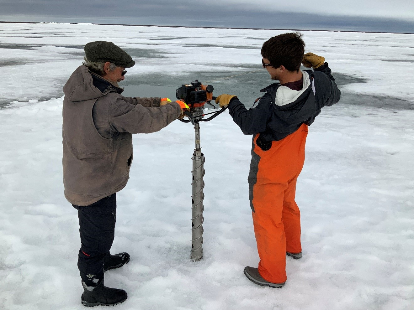 Out on the ice during SALVO fieldwork in the spring of 2019, Sturm (left) helps drill for an ice core. With him is University of Alaska Fairbanks technician Trevor Grams.