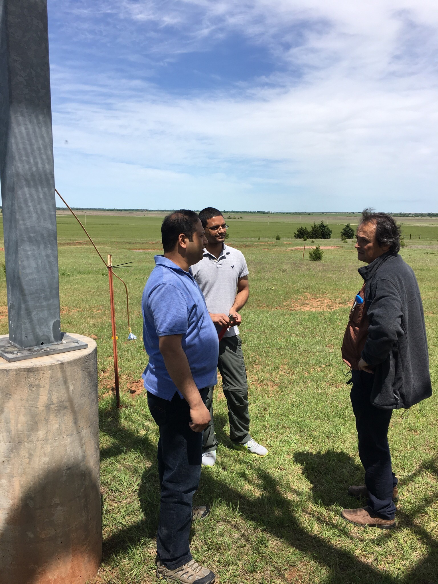 Laskin sometimes ventures out into the field and works closely with observational scientists. Here he is in 2016 at the SGP ARM site in Lamont, Oklahoma, with PNNL colleagues Gourihar Kulkarni, left, and Swarup China, middle. Photo is courtesy of Laskin.
