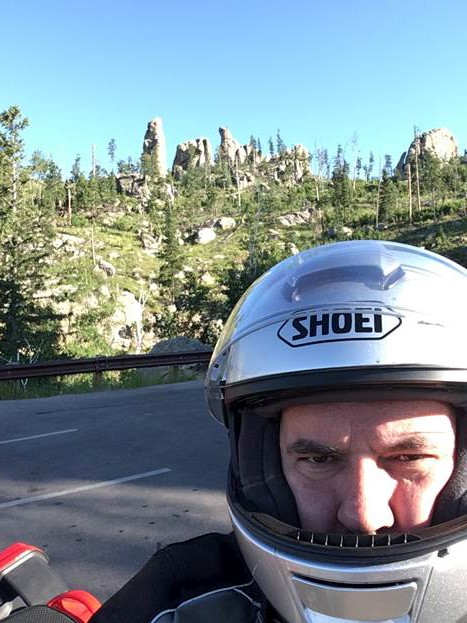 In life outside science, Mechem is (among many other things) an adventure motorcyclist. Here he is, pausing along Needles Highway in South Dakota. Photo is courtesy of Mechem.